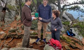 Carnegie Medal presentation at top of Squaw peak